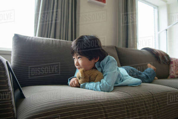 Boy (6-7) watching movie on tablet pc Royalty-free stock photo