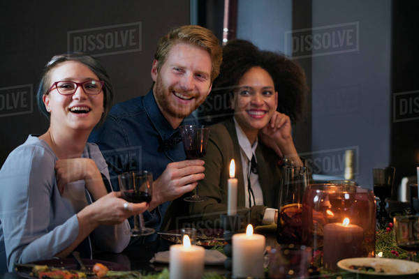 Friends enjoying meal at home during Christmas Royalty-free stock photo