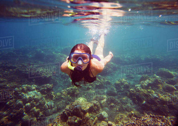 Portrait of young woman snorkeling in sea Royalty-free stock photo