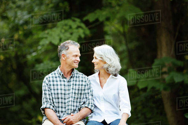 Mature couple smiling at each other and holding hands Royalty-free stock photo