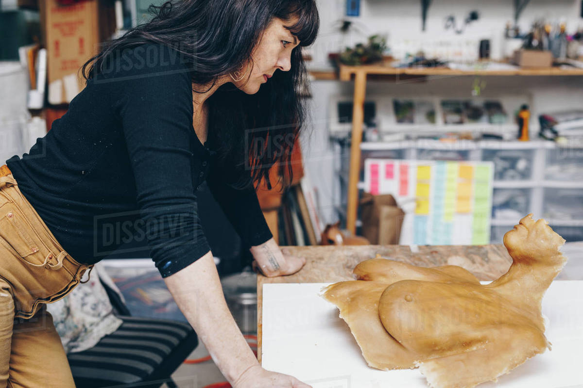 Artist looks at self portrait made of wax casting Royalty-free stock photo