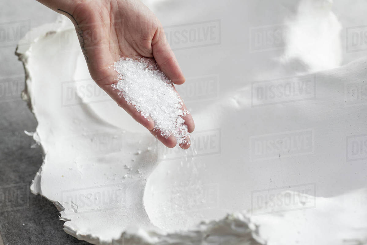 Frit glass being poured into plaster mold Royalty-free stock photo