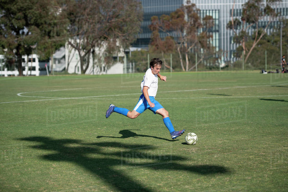Teen soccer player about to strike the ball on a free kick Royalty-free stock photo
