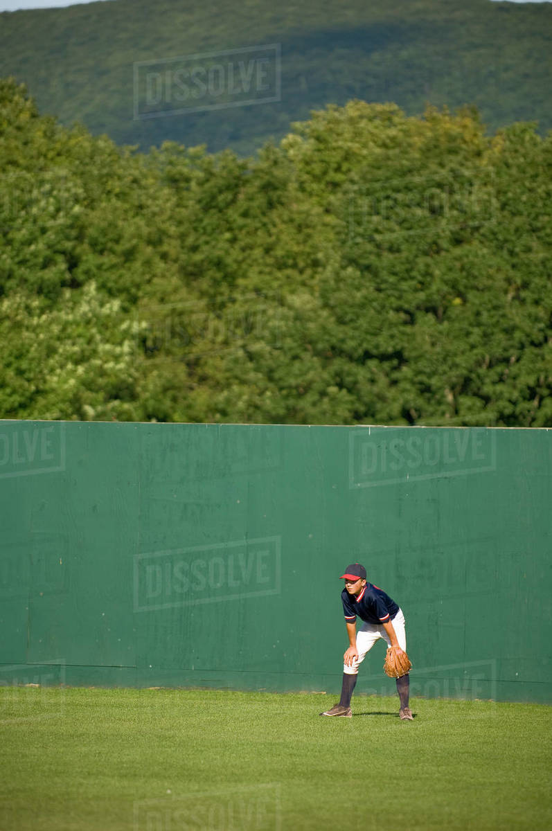 Boy in ready position in the outfield of a baseball field Royalty-free stock photo