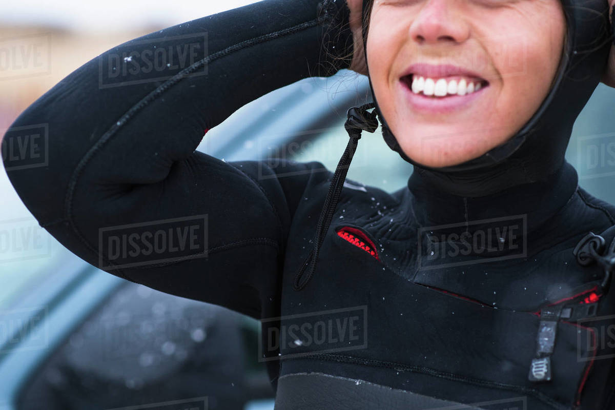 Young woman preparing for winter surfing in snow Royalty-free stock photo