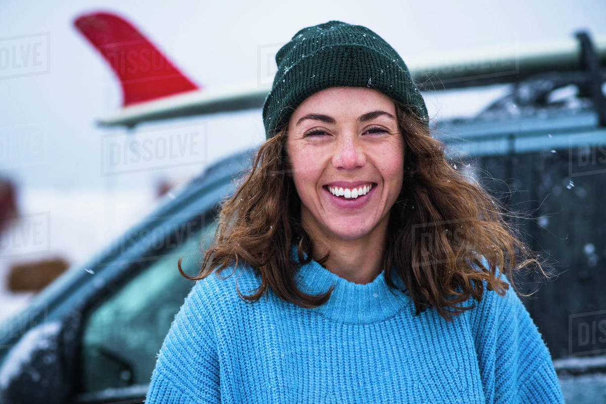 Woman surfer portrait with frozen surfboard Royalty-free stock photo