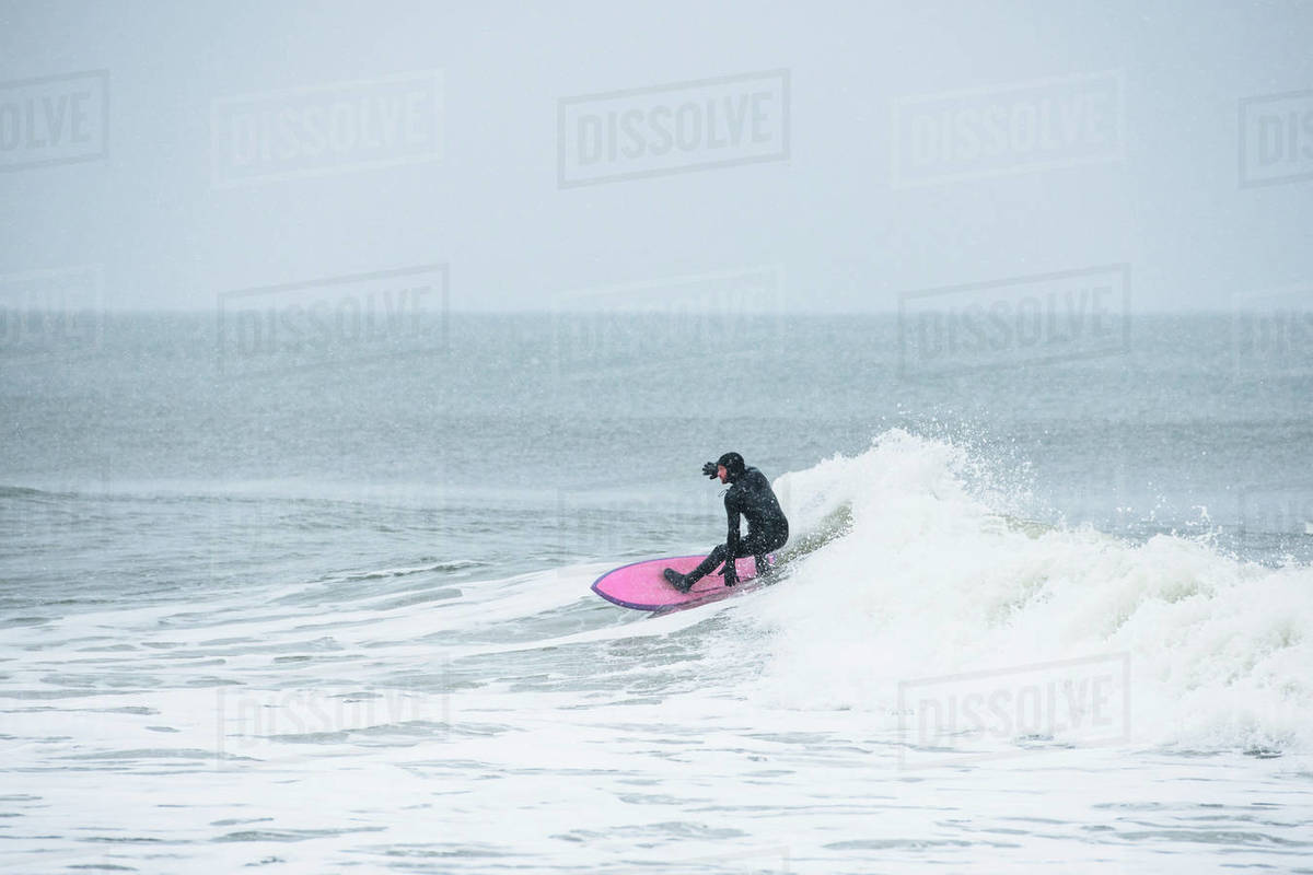 Man surfing during winter snow Royalty-free stock photo