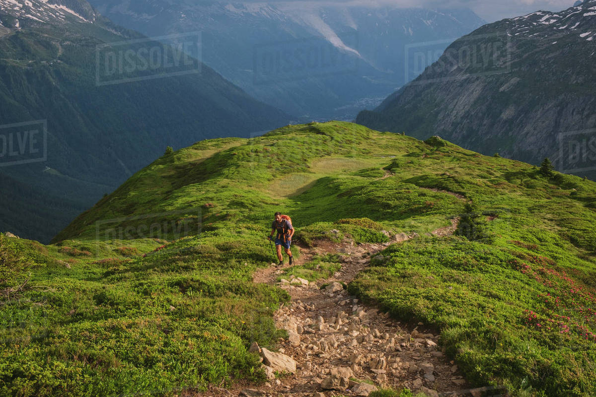 Young male hikes up to Aiguillette des Posettes, Chamonix, France Royalty-free stock photo