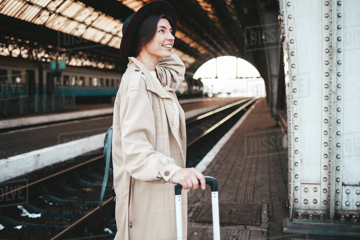 Pretty smiling woman at the railway station Royalty-free stock photo