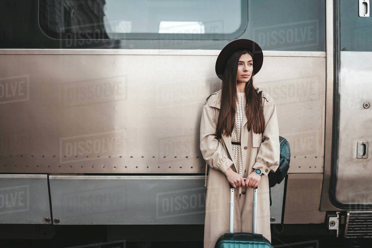 Portrait of a sad young girl traveler on the background of a train Royalty-free stock photo
