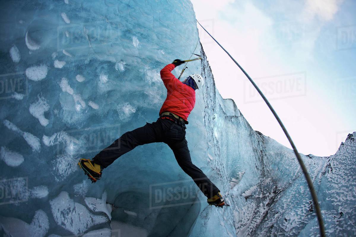Man climbing at Solheimajokull glacier in Iceland Royalty-free stock photo