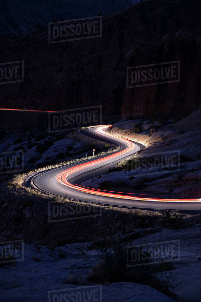 Car trails on the roads in arches national park Royalty-free stock photo