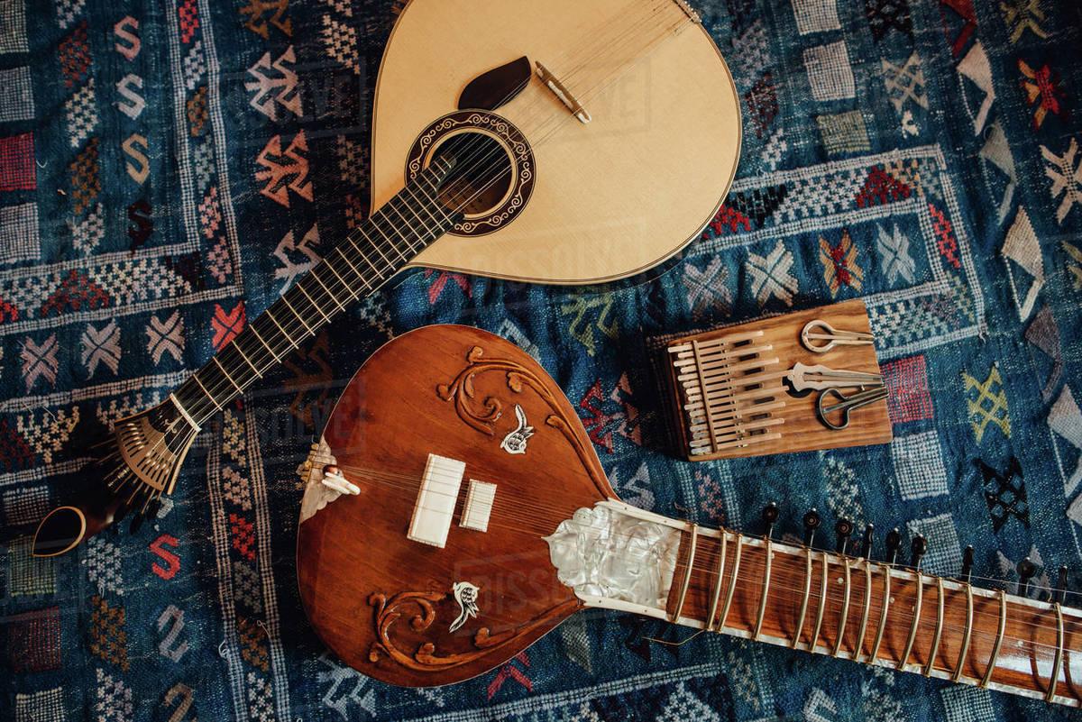 Traditional musical instruments: sitar, Portuguese guitar, kalimba Royalty-free stock photo