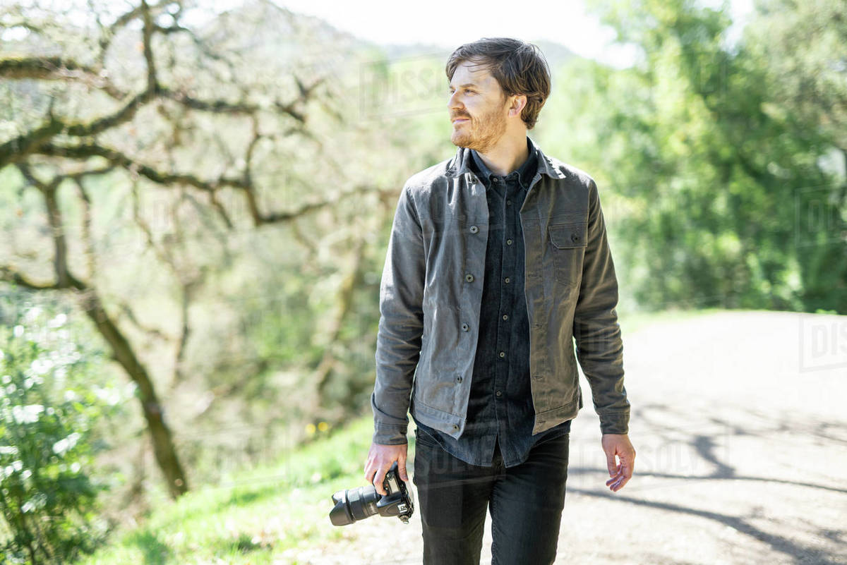 Portrait of hiker out shooting photos on sunny day in California Royalty-free stock photo