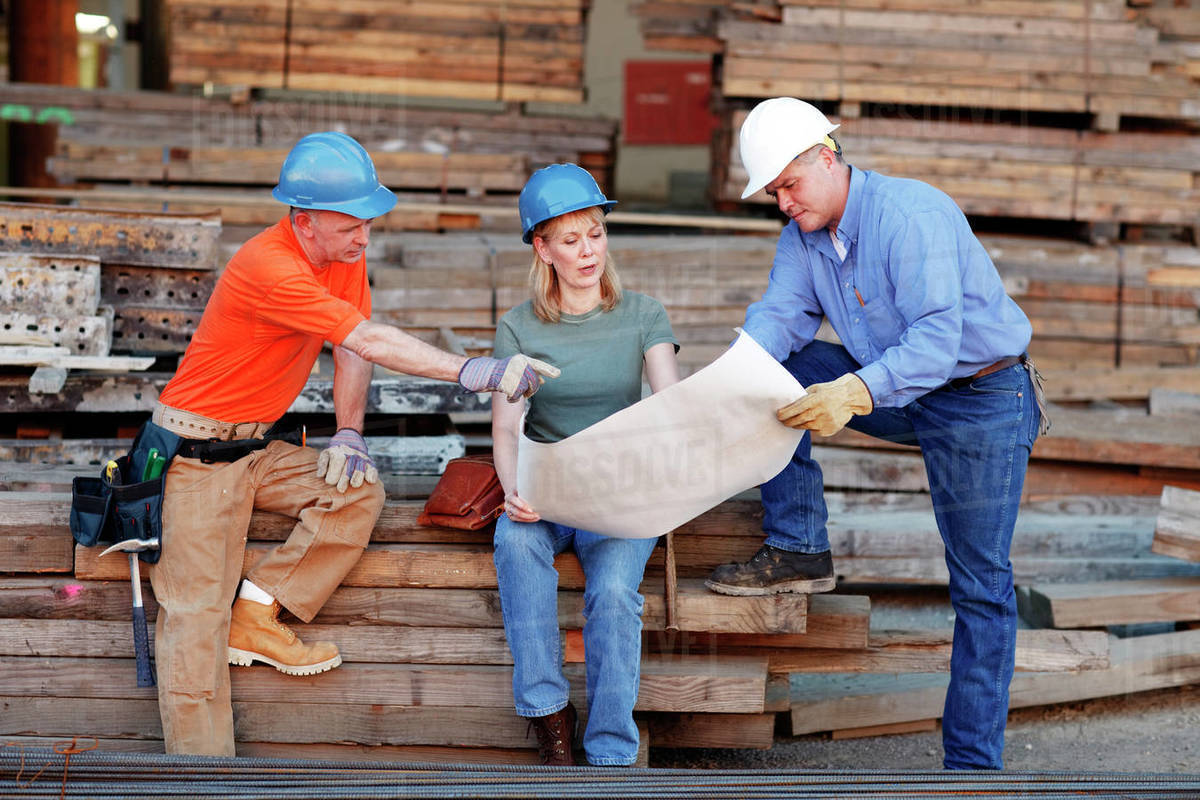 Group of construction workers looking over plans Royalty-free stock photo