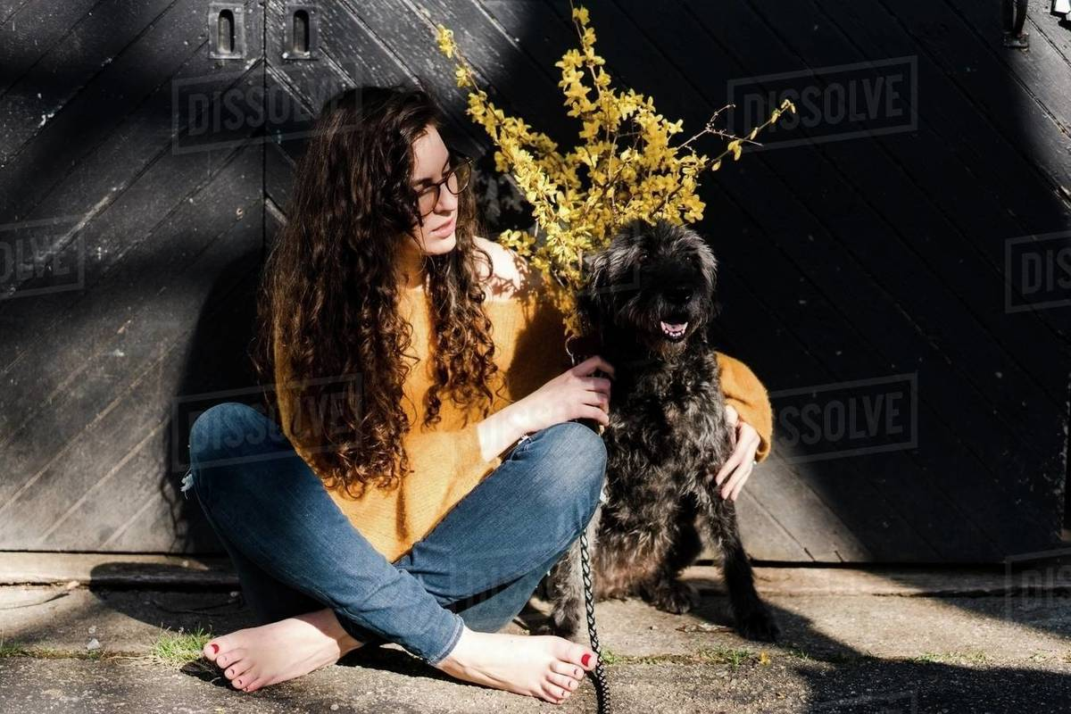 Pretty young woman with her dog  in the sunlight Royalty-free stock photo