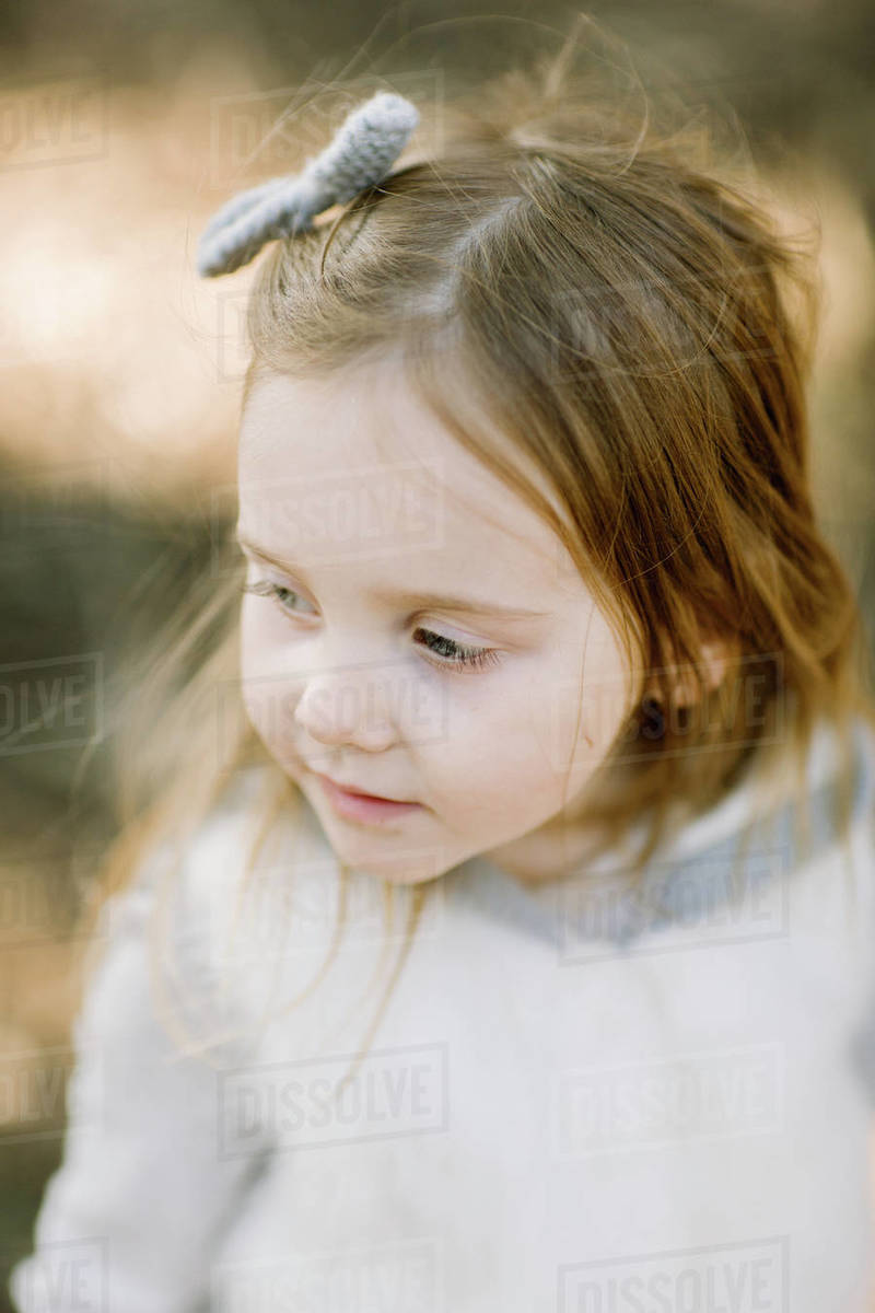 Toddle girl from above, closeup outdoors Royalty-free stock photo