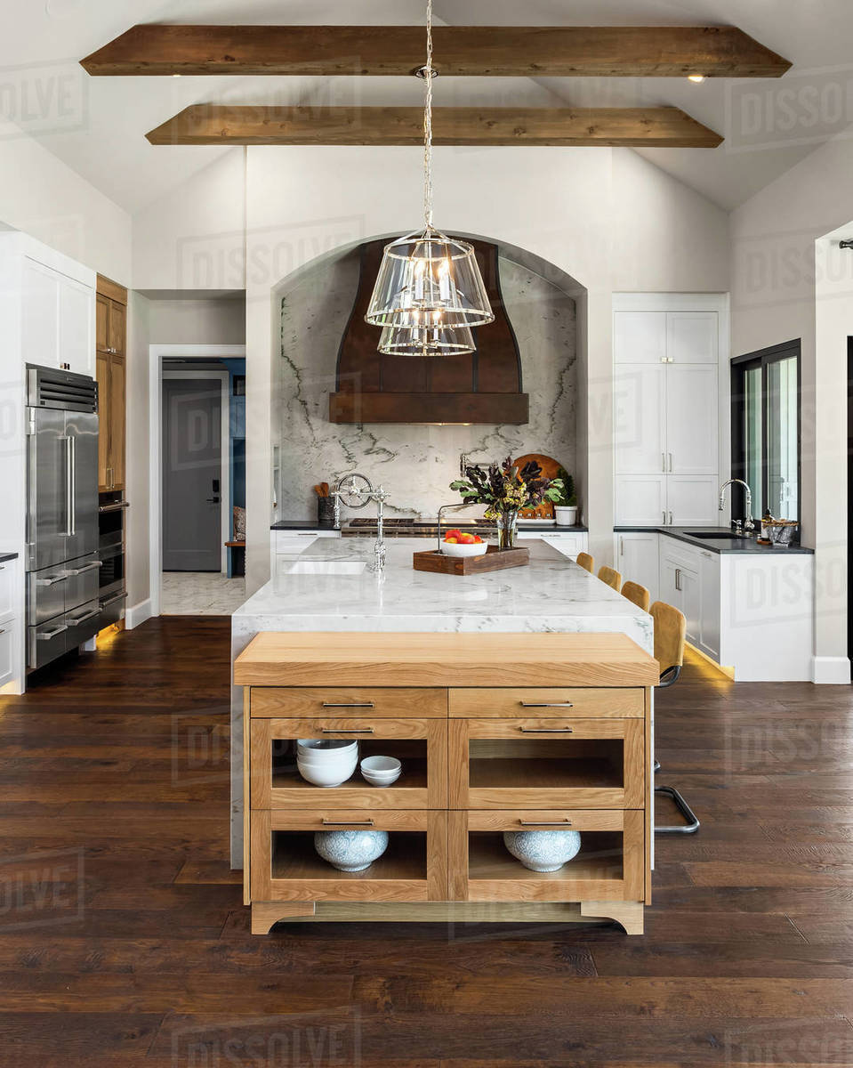 Kitchen in luxury home with large island and hardwood floors Royalty-free stock photo