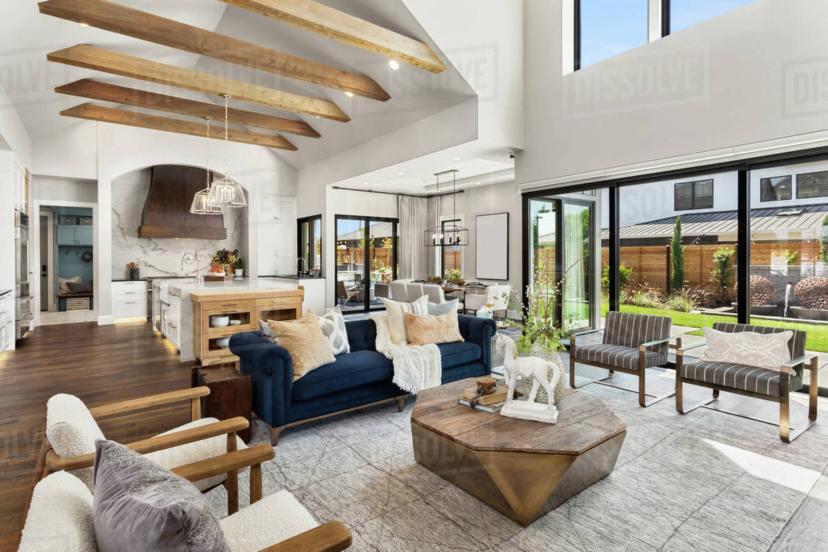 Living room and kitchen interior in new luxury home with large windows Royalty-free stock photo