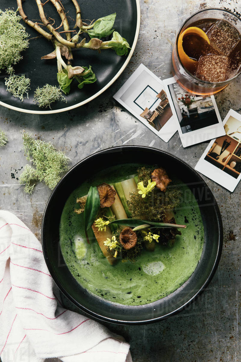 Overhead of foraged asparagus, mushrooms, and wild herbs in dish Royalty-free stock photo