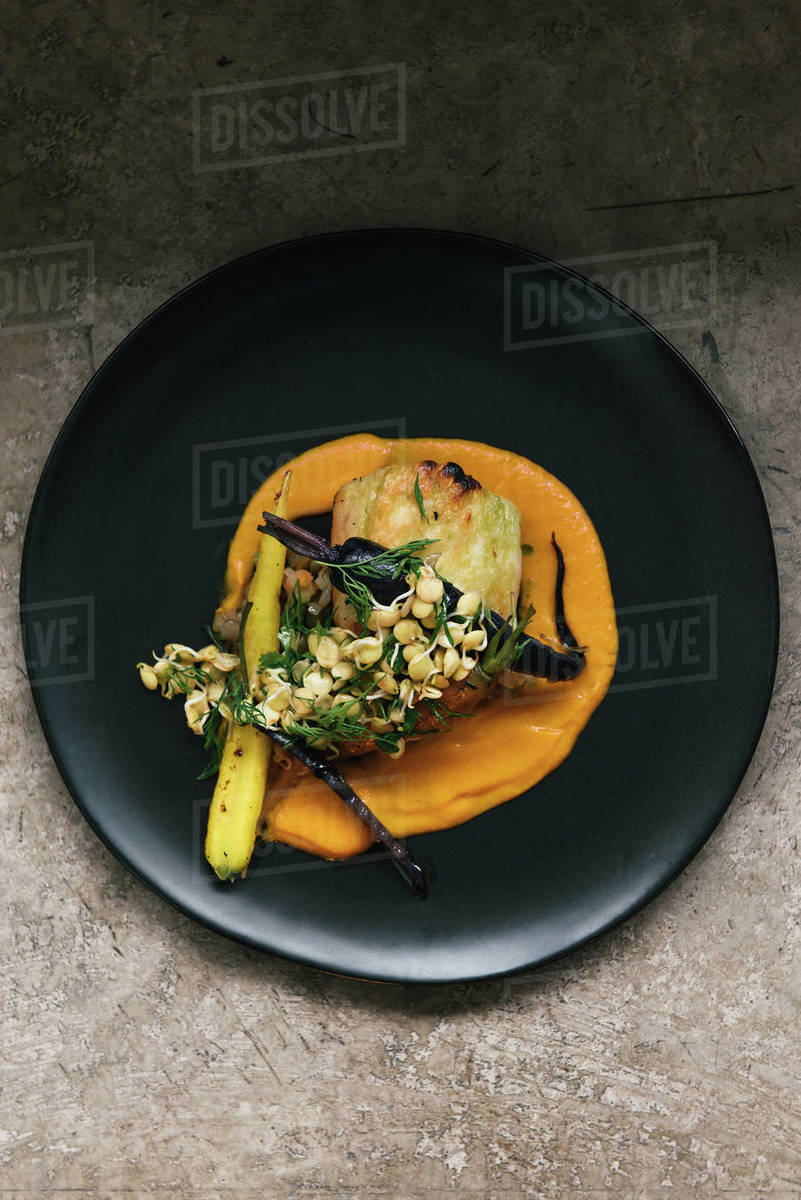 Colorful blend of roasted vegetables and sauce in Ecuadorian dish Royalty-free stock photo