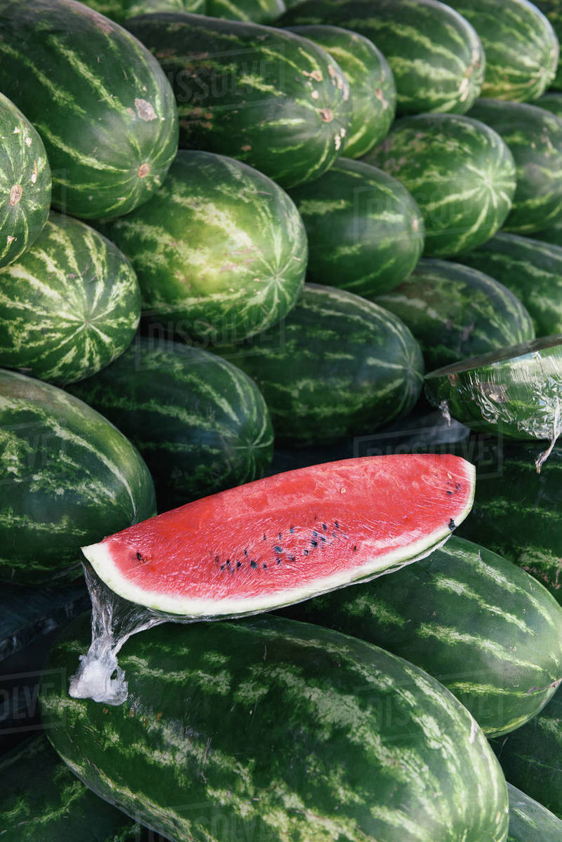 Stacks of watermelon from the farm at a produce market in Mexico Royalty-free stock photo
