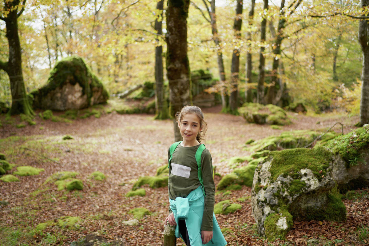 Girl walking through a beech forest Royalty-free stock photo