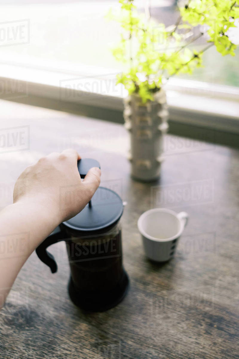 Spring blooms and coffee at home during the coronavirus quarantine. Royalty-free stock photo