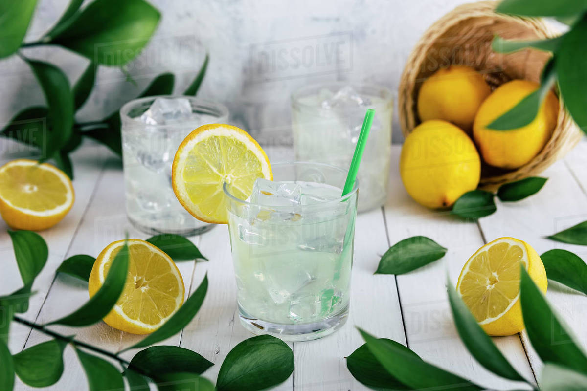 Lemon soda glasses with ice on a table at an outdoor picnic in nature Royalty-free stock photo