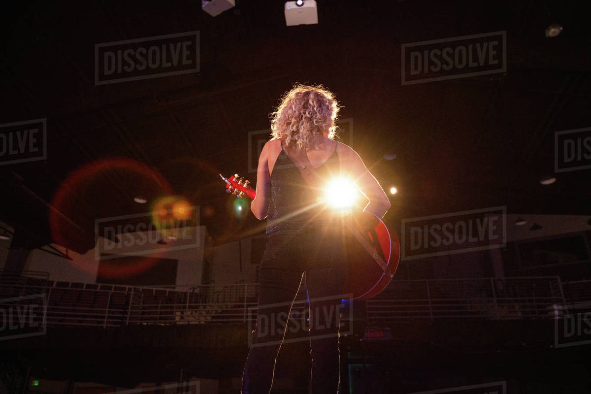 Female musician playing music on stage Royalty-free stock photo