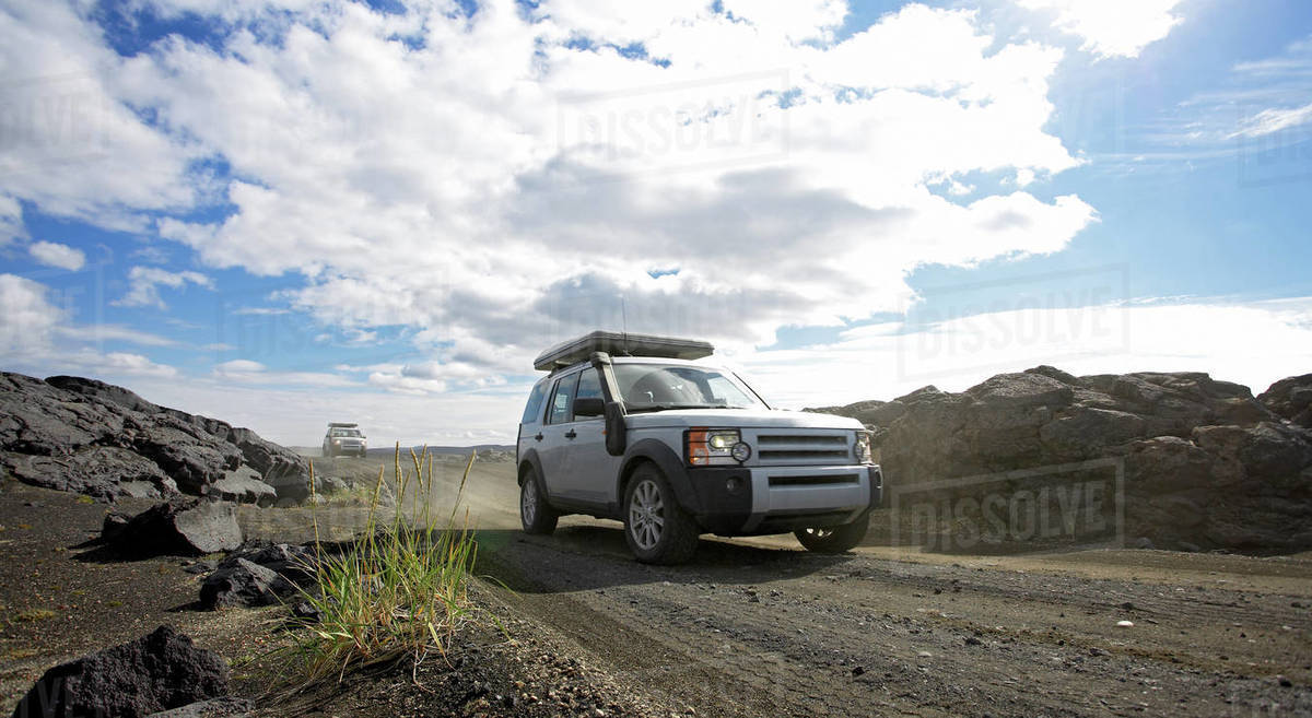 SUV's driving on dusty road in central Iceland Royalty-free stock photo