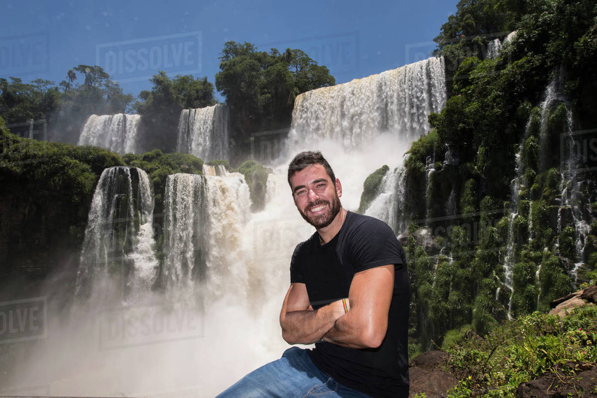 Young man posing in front of the Iguacu waterfalls in Argentina Royalty-free stock photo