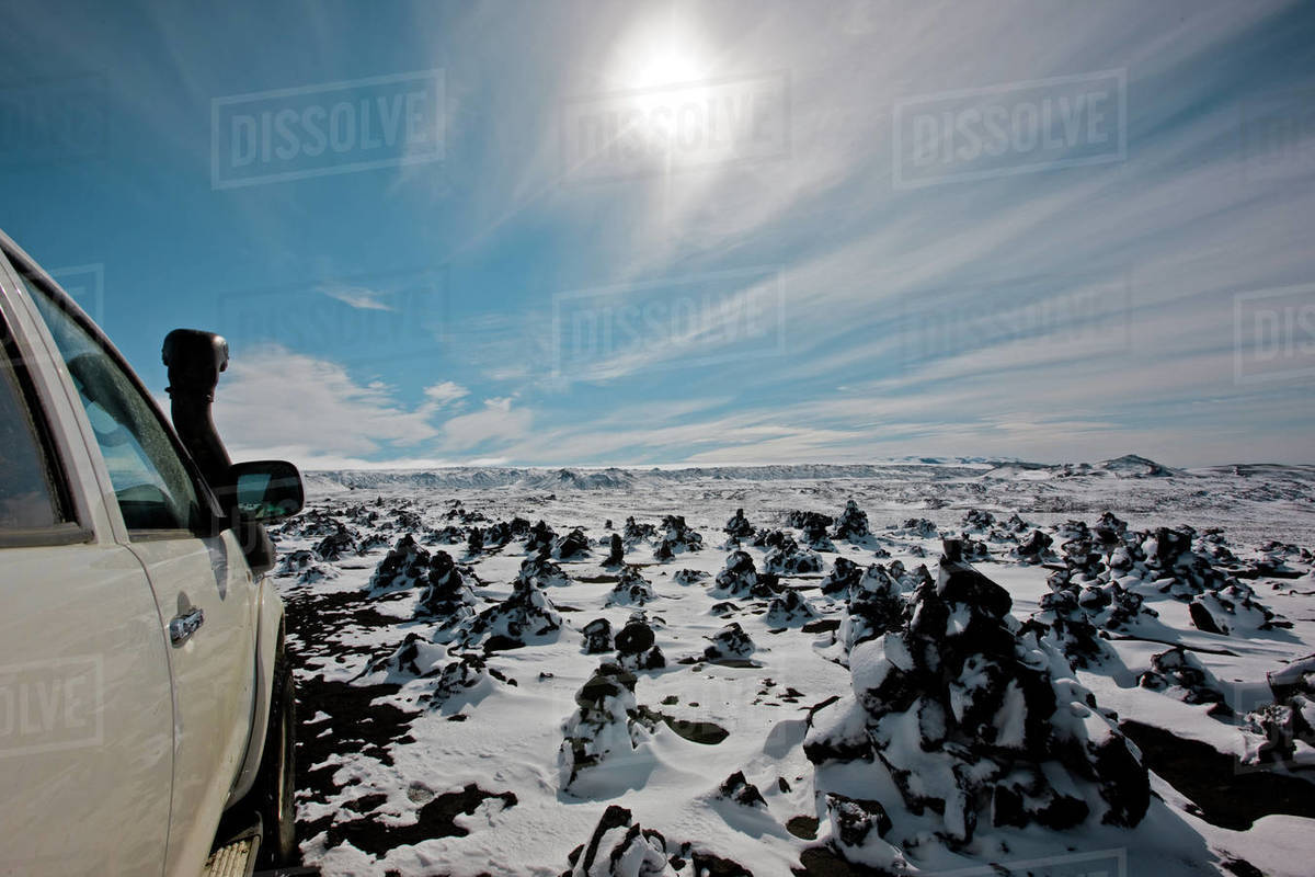 SUV driving through snowy landscape in the Icelandic highlands Royalty-free stock photo