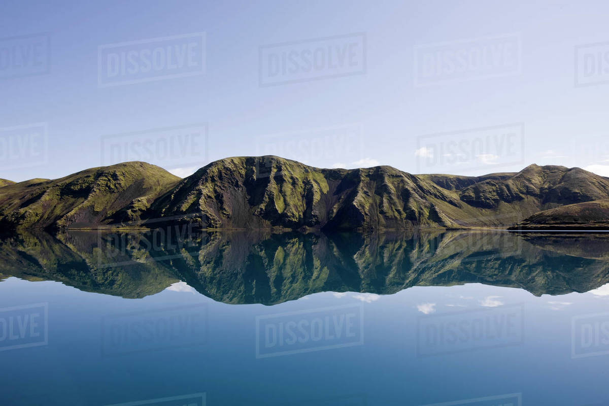 Reflection of mountain range in still lake on the Icelandic highlands Royalty-free stock photo