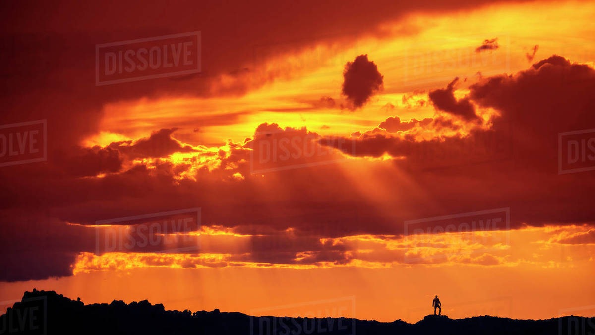 Silhouette of Man Standing In Desert Landscape Under Incredible Sunset Royalty-free stock photo