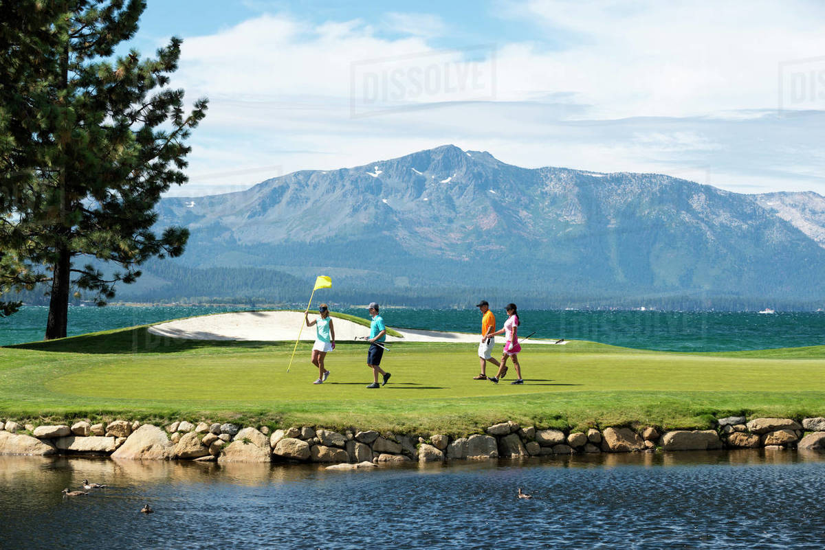 A group of friends golfing at Edgewood Tahoe in Stateline, Nevada. Royalty-free stock photo
