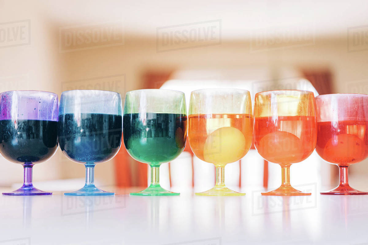Rainbow array of cups with Easter egg dyes Royalty-free stock photo