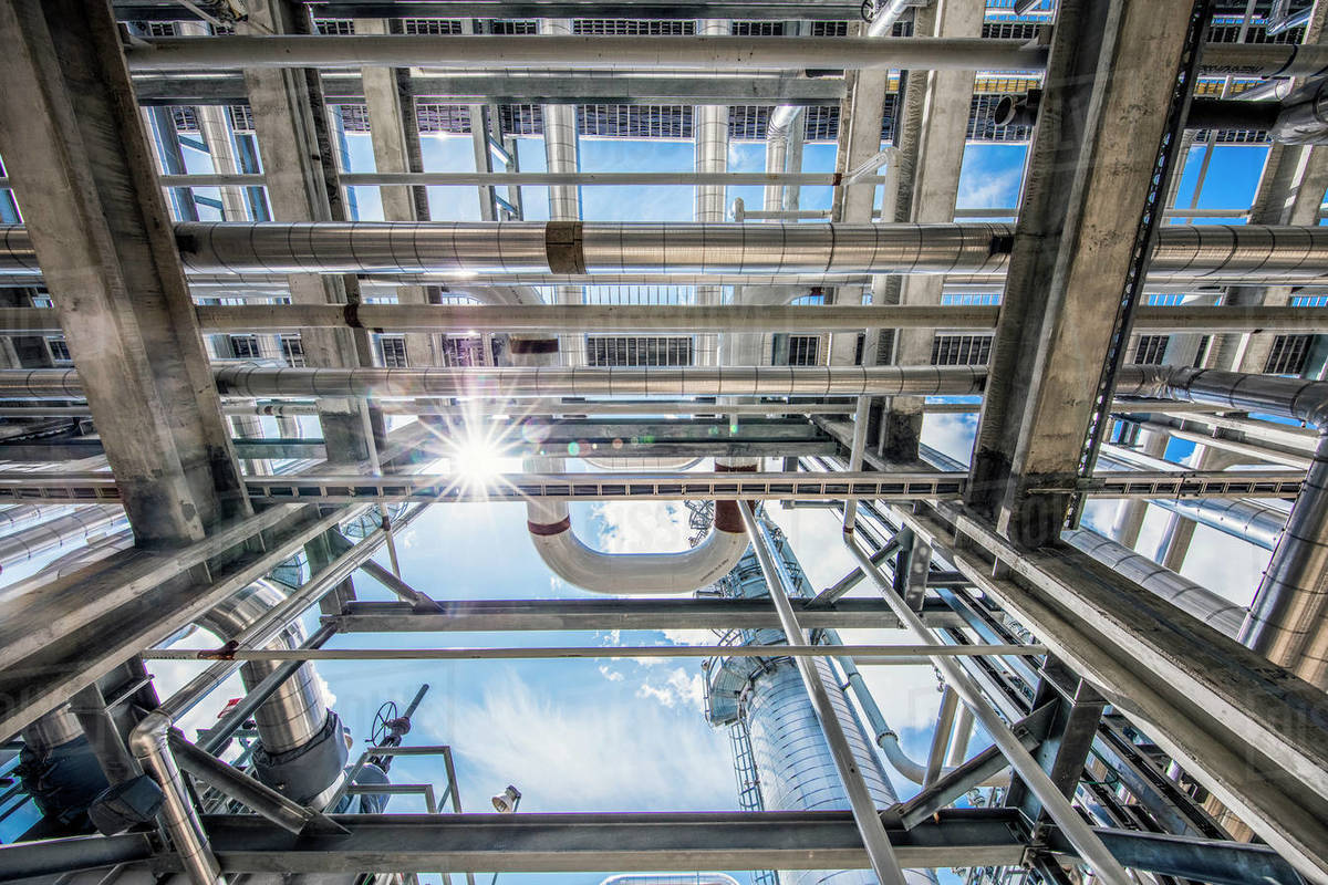 Natural gas processing plant structures with sun flare Royalty-free stock photo