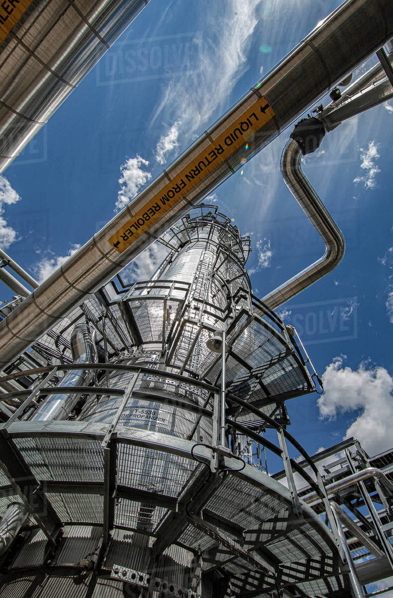 Natural gas plant structures against blue sky Royalty-free stock photo