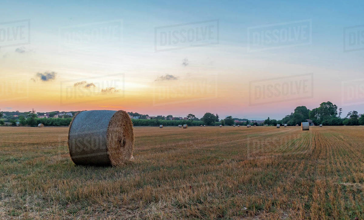 Rural village with straw bales at sunset on the Mediterranean coast Royalty-free stock photo