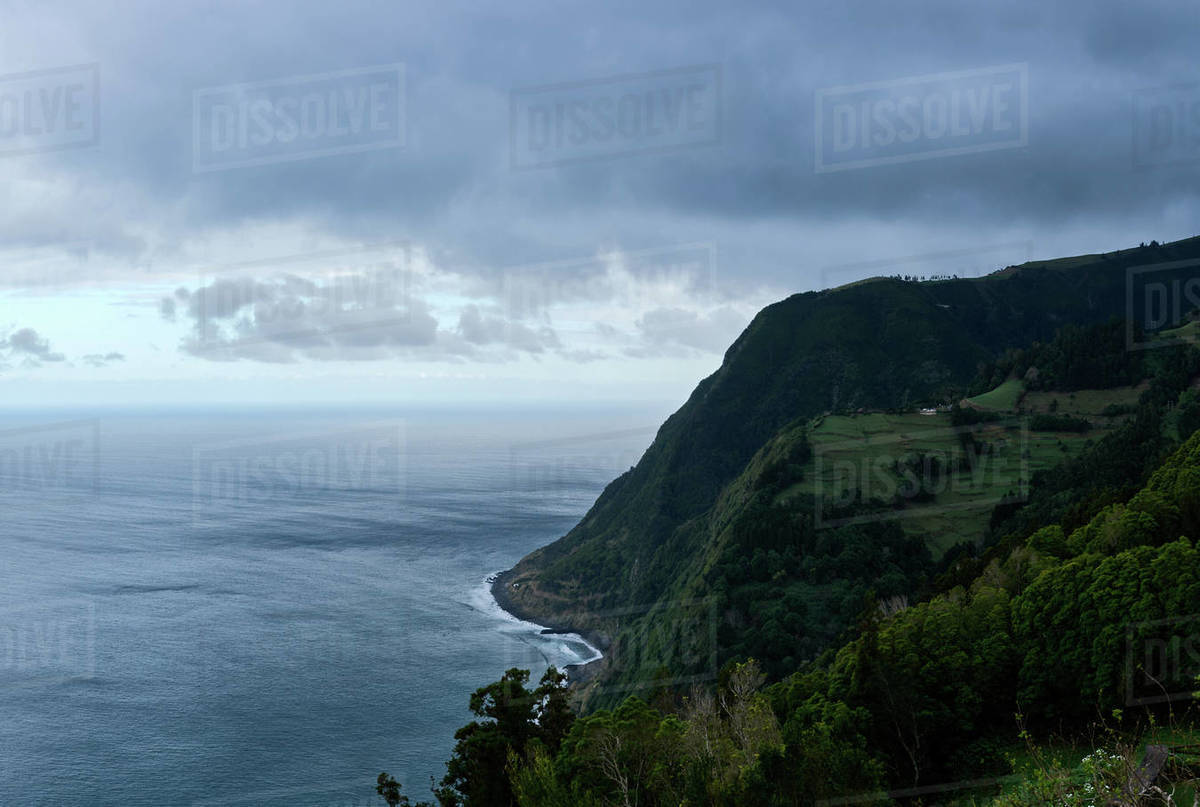 Landscape of the sea and greenish mountain in Sao Miguel, Azores Royalty-free stock photo