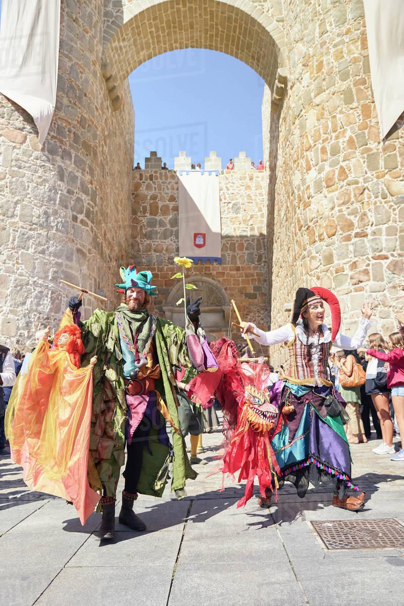 A medieval festival parade next to the wonderful wall of Avila. Avila, Spain Royalty-free stock photo