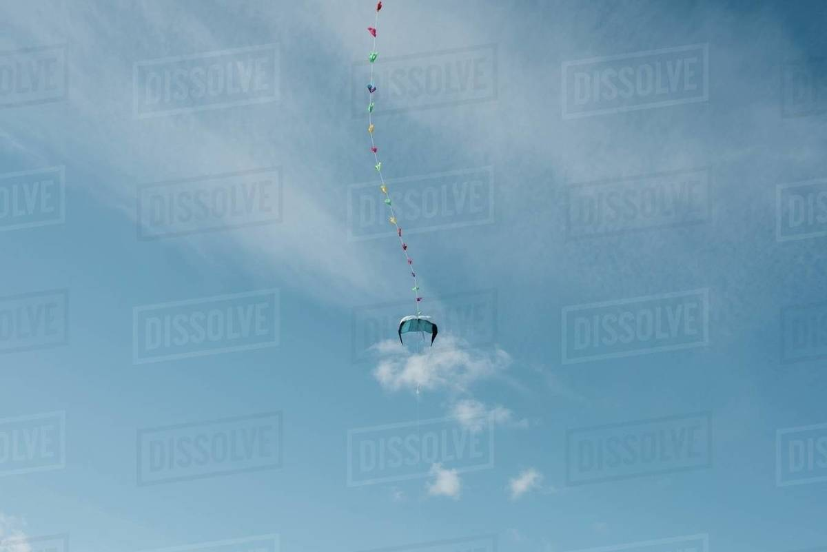 Colourful kite in the sky with fluffy clouds and blu skies Royalty-free stock photo