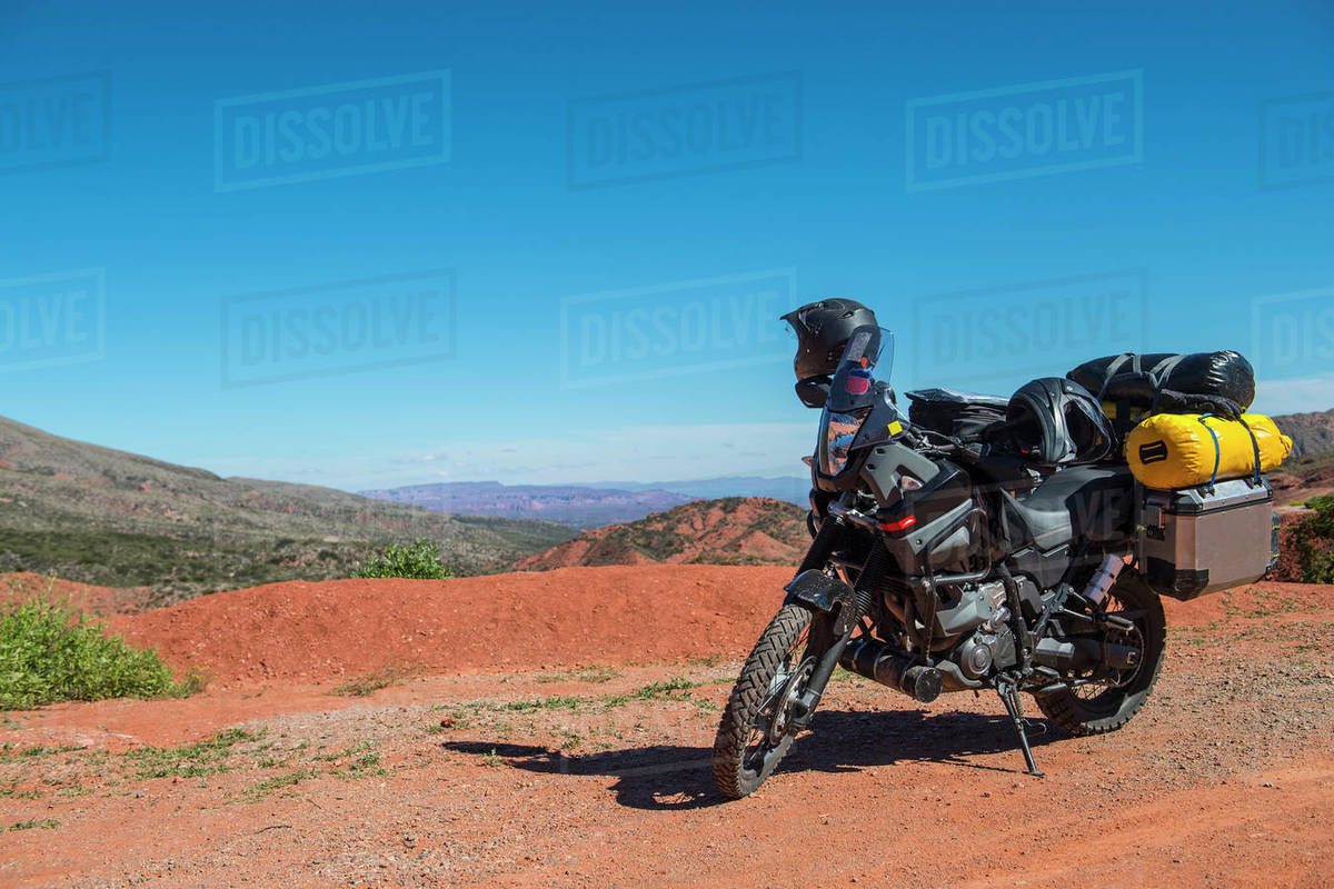 Touring motorbike parked on dirt road, Salta, Argentina Royalty-free stock photo