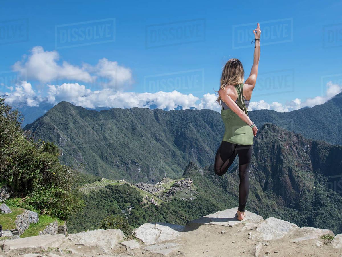 Woman practising yoga on the Inca Trail close to Machu Picchu Royalty-free stock photo