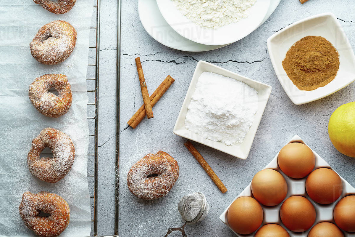 Small doughnut of wine with sugar and cinnamon and ingredients. Donuts dessert Royalty-free stock photo