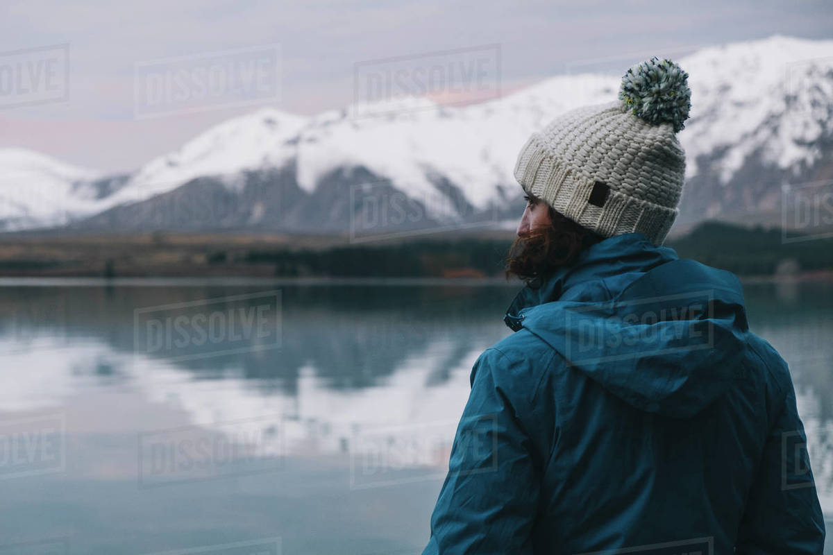 Young woman looking at the southern alps reflection over Lake Tekapo Royalty-free stock photo