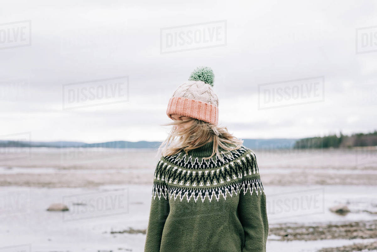Portrait of woman standing with the wind blowing in her hair Royalty-free stock photo