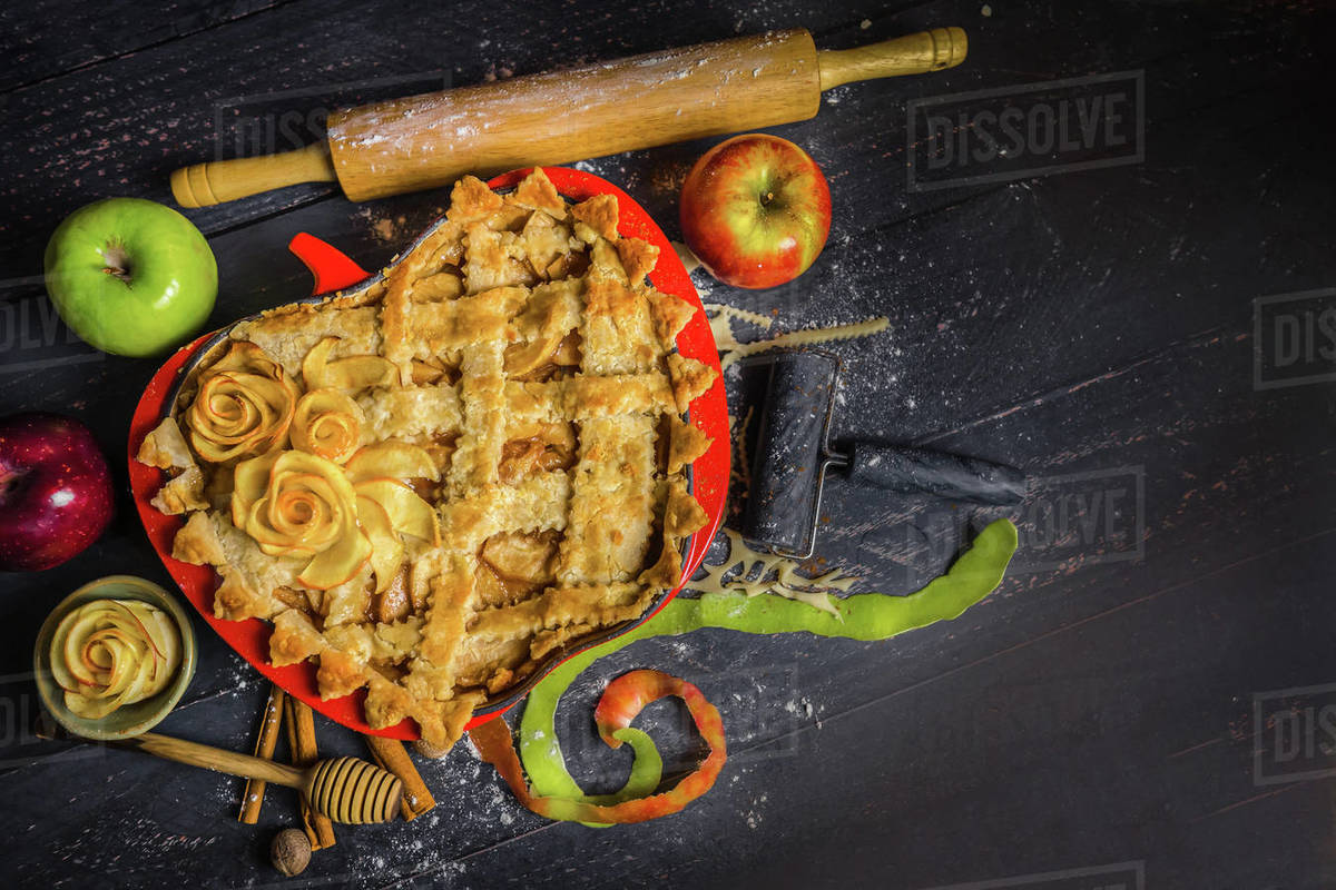 Apple pie plate decorative wood cinnamon baking honey food prep styled Royalty-free stock photo