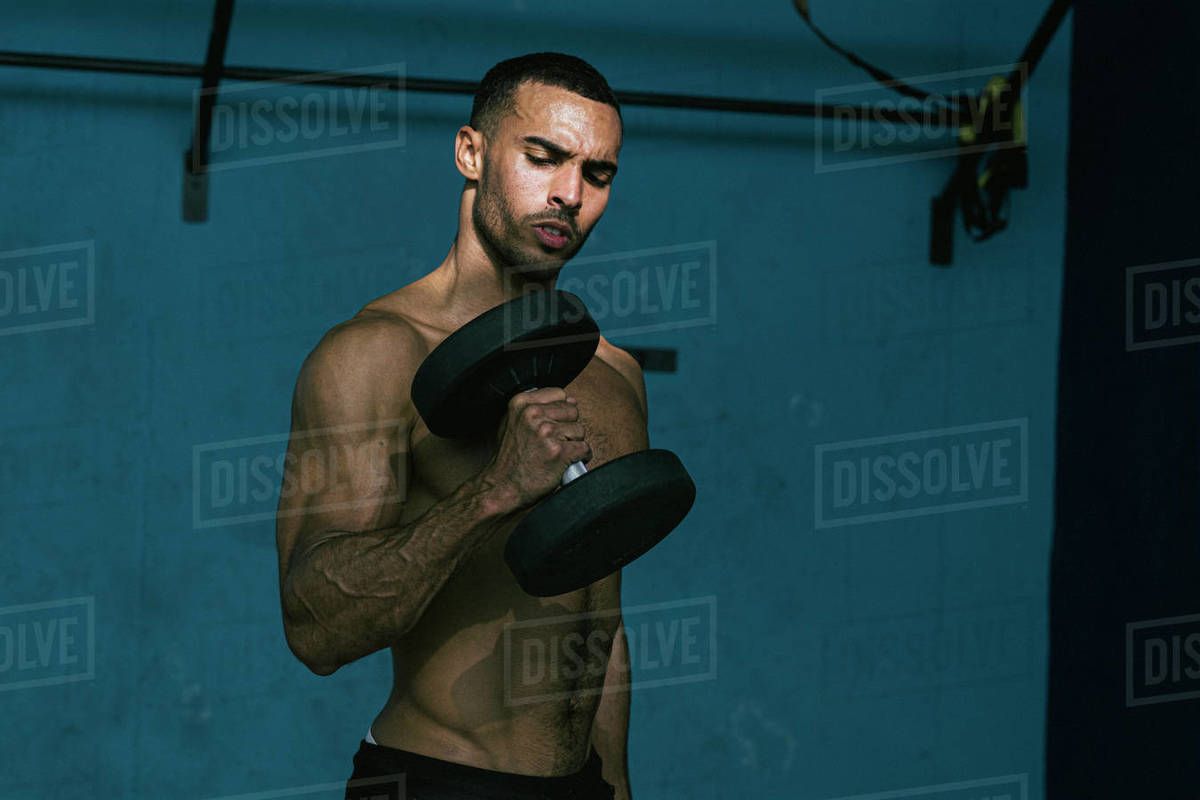 Male african american athlete with no shirt lifting weights Royalty-free stock photo